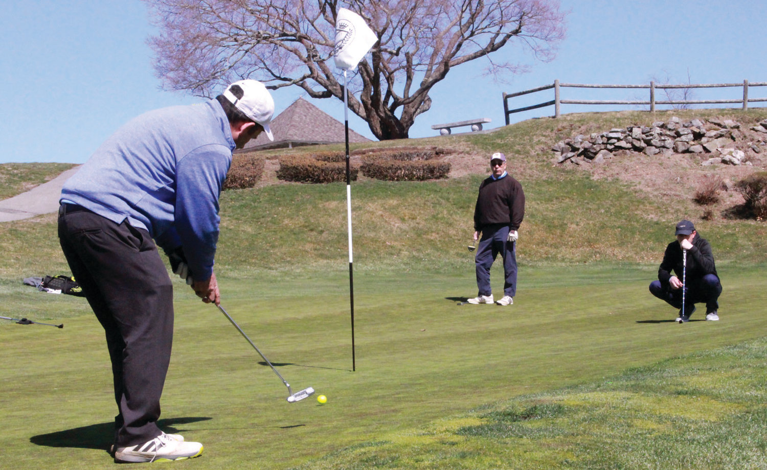 HITTING THE LINKS: Local golfers putt last weekend.