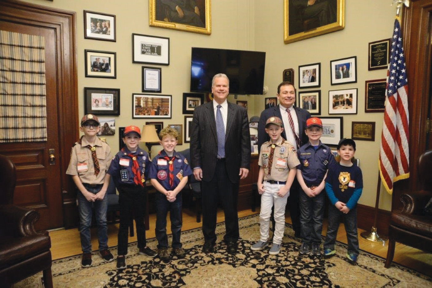 SCOUT'S HONOR: Speaker Nicholas Mattiello and Majority Leader Joseph Shekarchi with pictured with members of Pack 1 Warwick and Pack 6 Cranston.