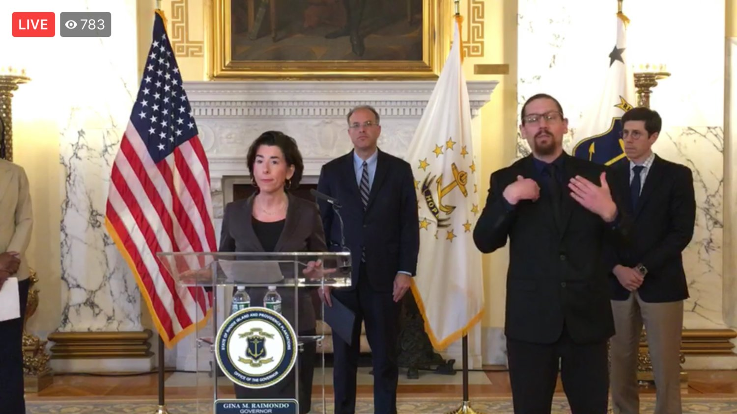Gov. Gina Raimondo speaks during Saturday's daily briefing at the State House.