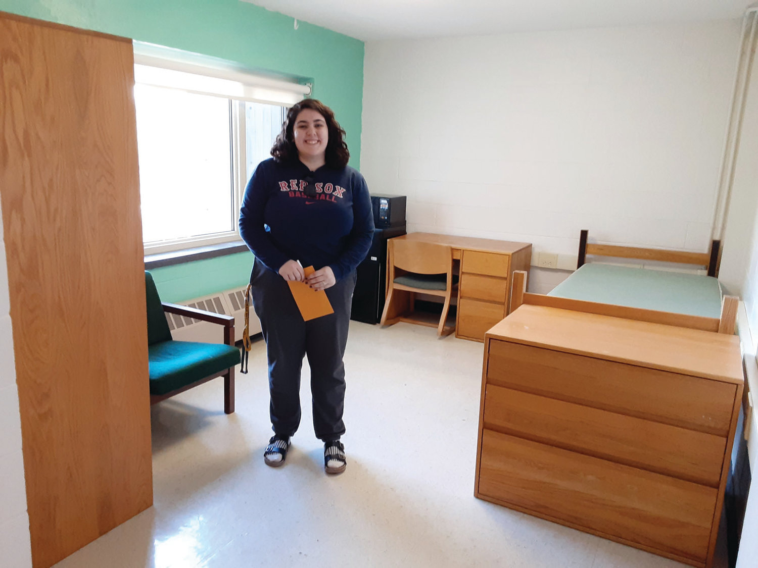 SMILING DESPITE THE CRISIS: Our oldest daughter gave me a brave smile as we took one last picture of her in her dorm room. The rest of her sophomore year would be completed at home.