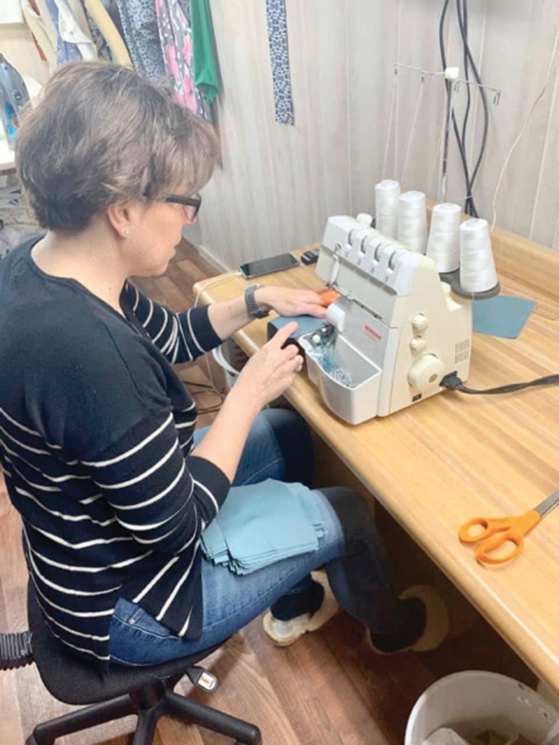 CRANKING THEM OUT: Kim Allen Larson of Warwick is among the ranks of volunteers who have turned to their sewing machines to produce surgical masks.
