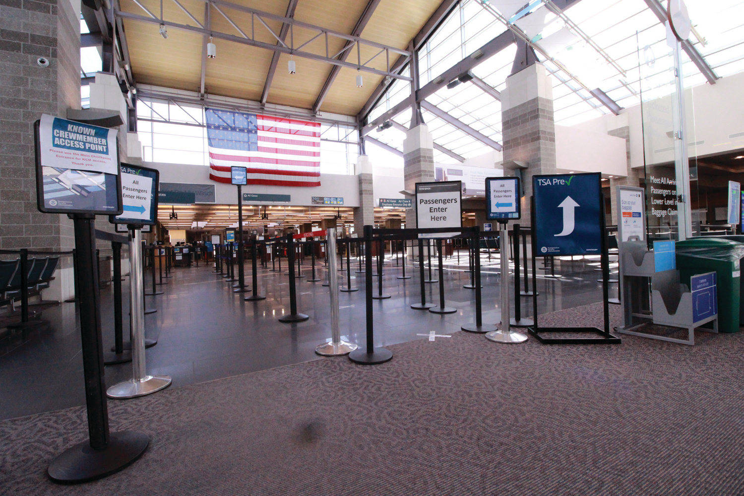 NO WAITING, NO PASSENGERS: There were no lines at the TSA checkpoint at Green Airport Monday.