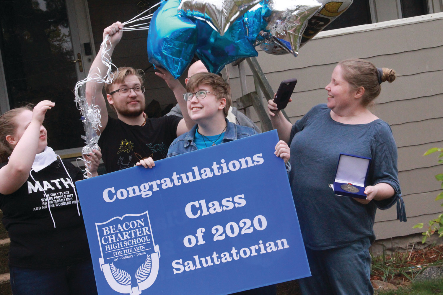 BLOWN OVER: Bethany Crawford is joined by her family outside their Warwick home where she learned she is the Class of 2020 Salutation at Beacon Charter School for the Arts and Founders Academy in Woonsocket.