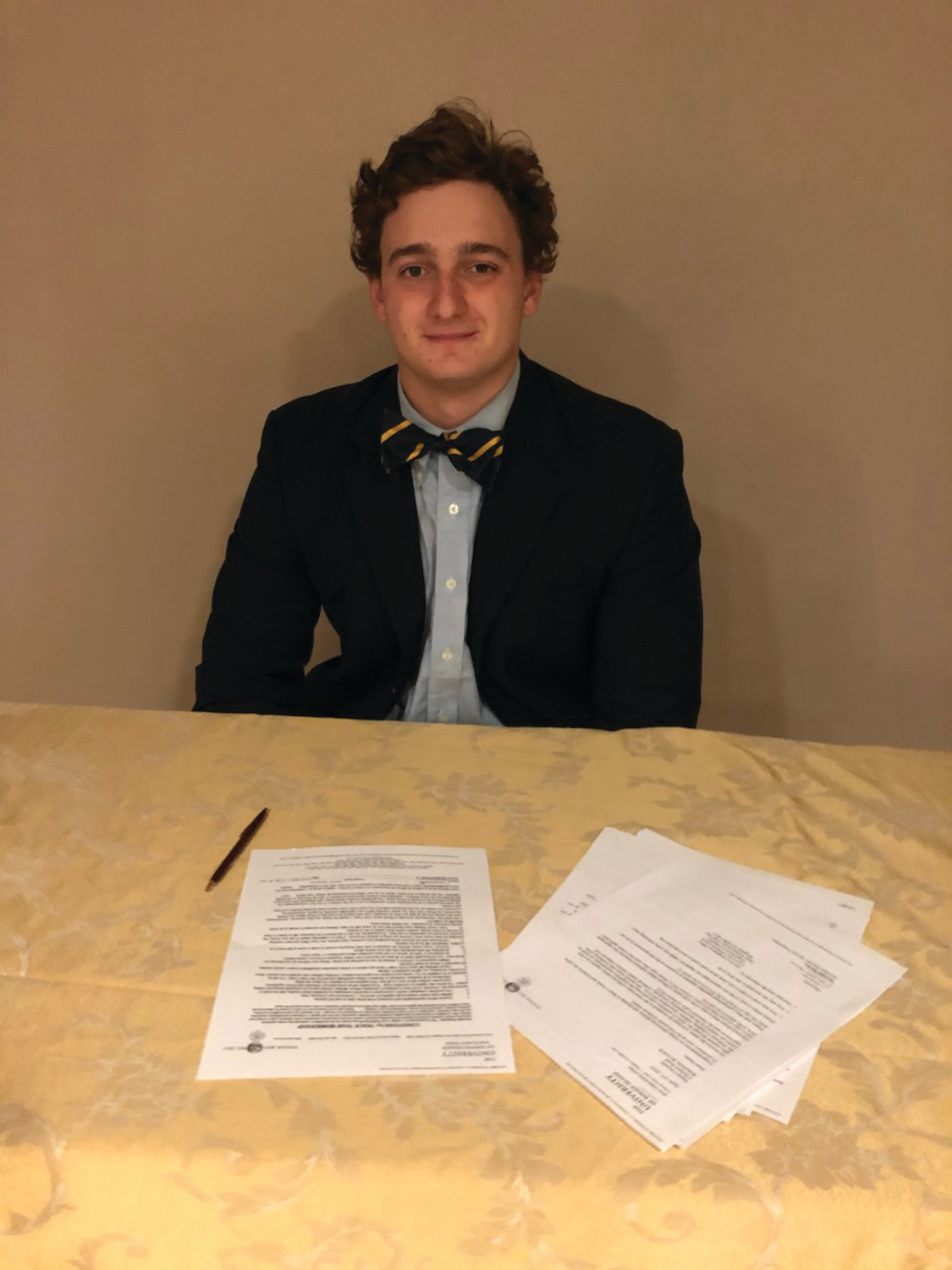 COLLEGE THROWER: Dante Caouette signs his NLI to throw for URI.