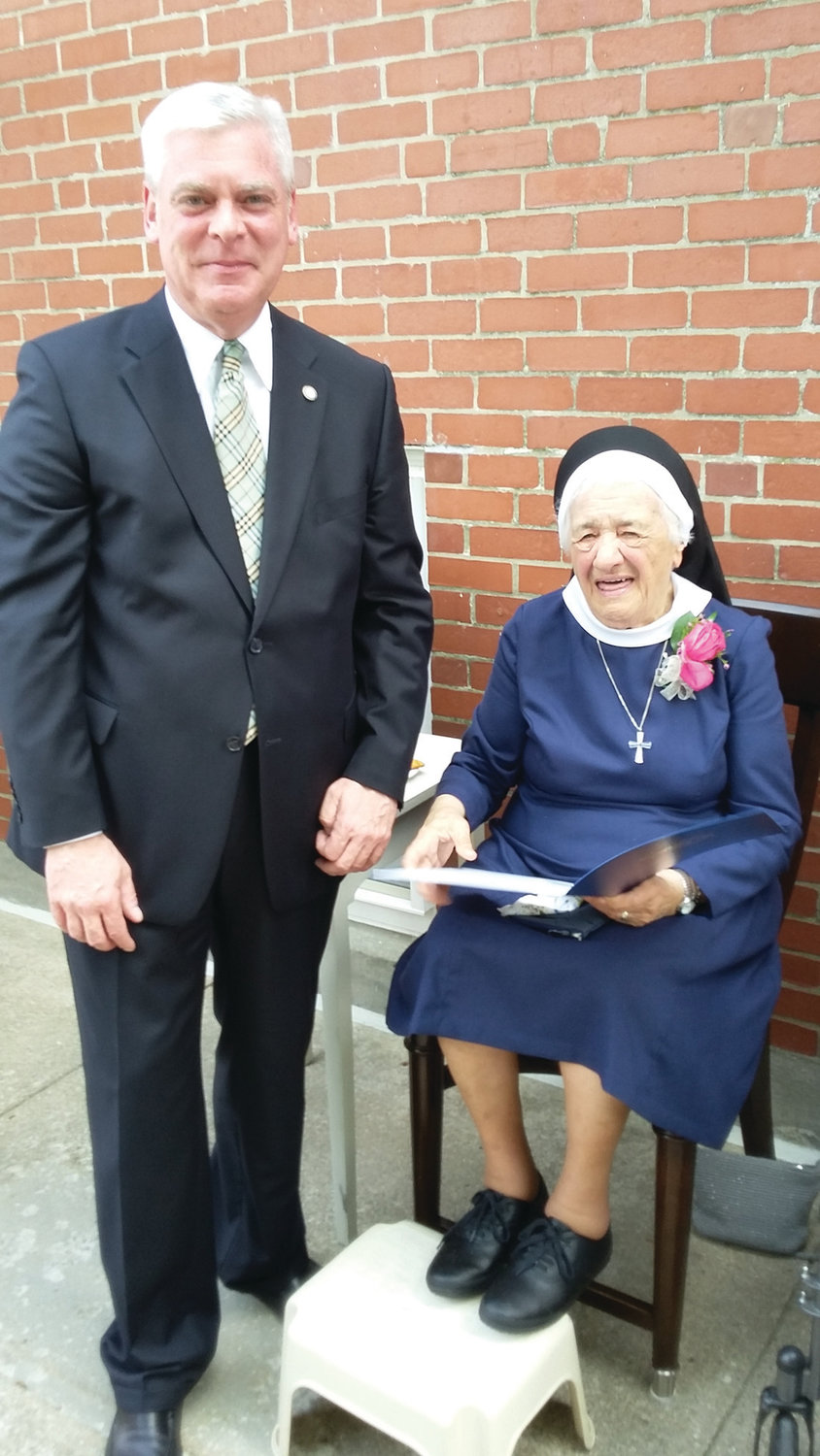 RECOGNITION: Scott Avedisian presents Sister Mary Angelus a citation in recognition of her work in this photo taken when he was mayor.