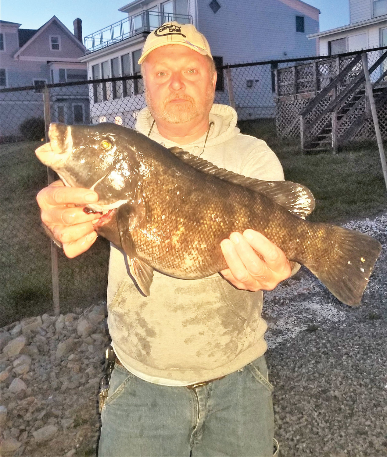 "Michael Mercer of Riverside with a tautog he caught along the Providence River. Mike said, ""The jigs are out producing the hook and sinker rig ten to one."""