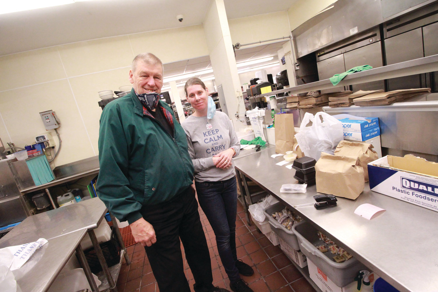 LULL BEFORE THE ACTION: Craig Callen and his daughter Audra are seen in the kitchen of the Gov. Francis Inn Friday afternoon before he put on an apron to help meet take-out orders.