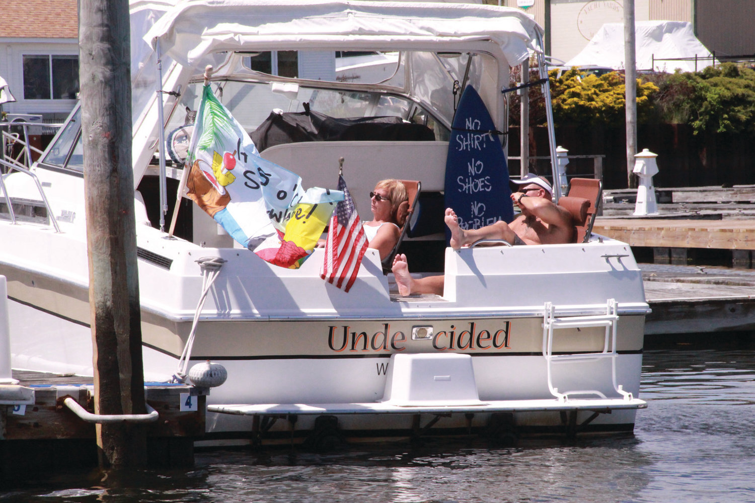 UNDECIDED WHAT TO DO THIS SUMMER? This couple found a great way to enjoy the outdoors, and there's no need to worry about masks from this boat in Warwick Cove.