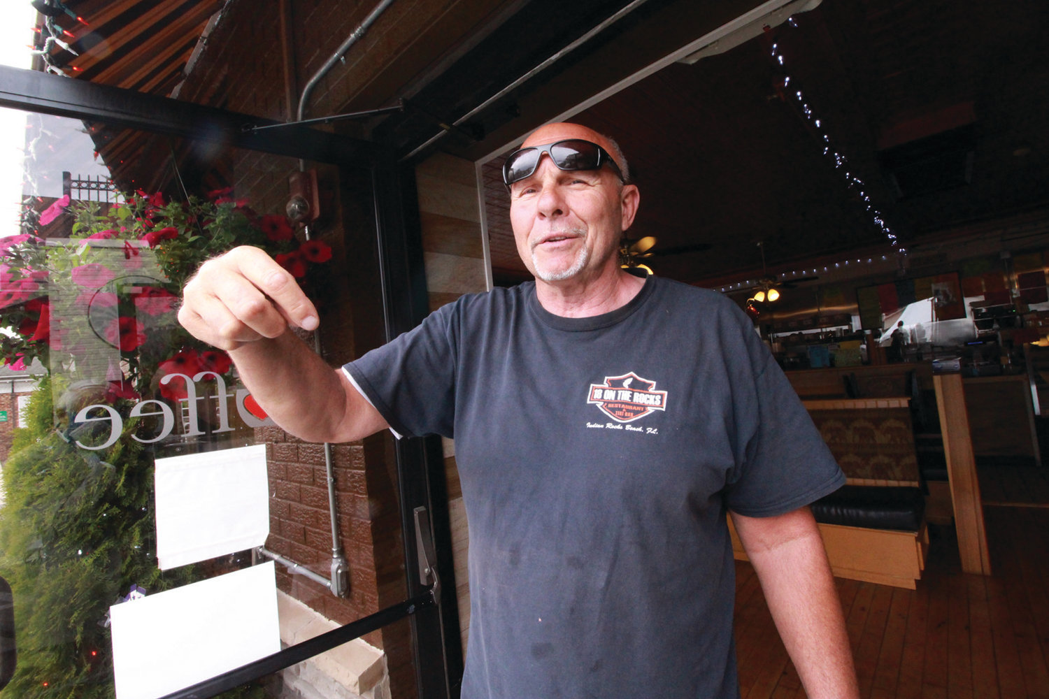 DELIGHTED TO SEE PEOPLE: Bagels Express Deli & Café co-owner Ray Verrocchio isn't troubled that he's losing some parking so that Revolution and Fellini's Pizzeria can offer outside dining in tents.