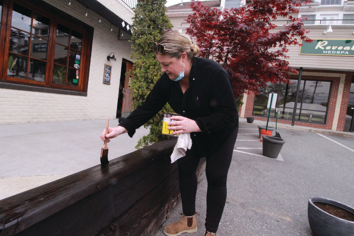 FRESHENING THINGS UP: Kristy Knoedler, owner of Fellini's, brightens the front of the restaurant that will offer outside seating under a tent.