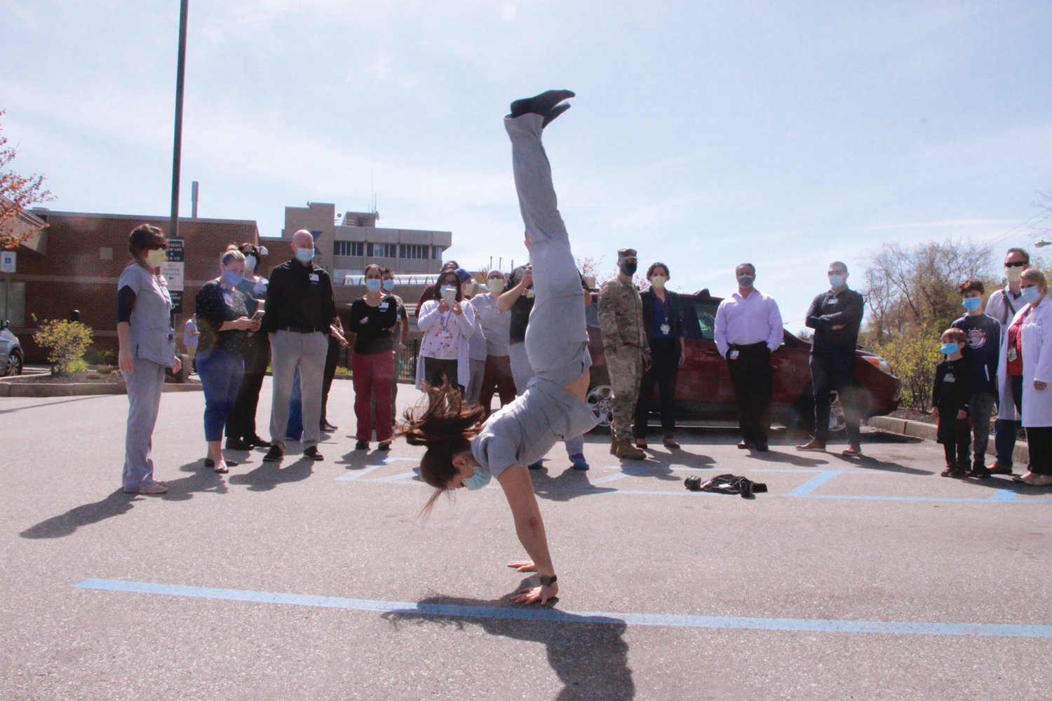 FLIPPING OUT FOR THE GUARD: Physical therapist and fitness trainer Erica Migneault was among the hospital staff who watched the National Guard parade, but she was the only one to do a back flip in response.