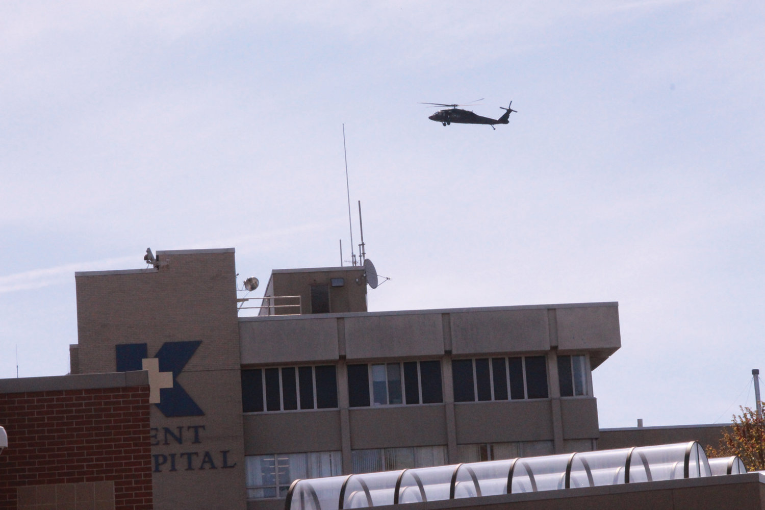 SALUTE FROM THE AIR: A National Guard Blackhawk lingered over Kent as personnel on the ground drove by the hospital.