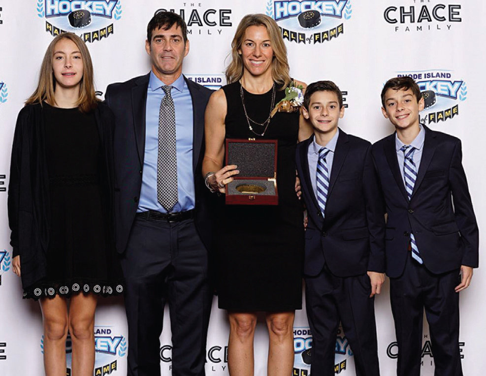 HALL OF FAMER: Sara DeCosta-Hayes and her family are during a previous Rhode Island Hockey Hall of Fame induction ceremony. This year's event has been postponed.