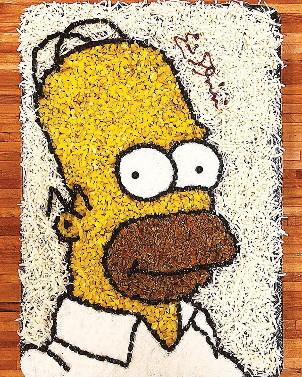 PIZZA 'D'OH!' Homer Simpson is one of the many cartoon characters Eric Palmieri has perfected since beginning his custom pizza journey in 2017. He enjoys the challenge of requests from customers, and enjoys assembling intricate designs.