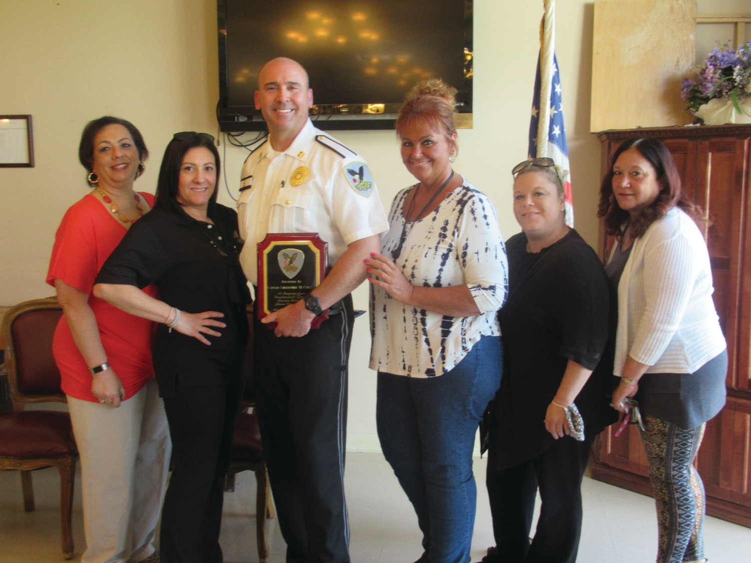 SUPER SUPPORTERS: Among the many JPD staff members who wished Capt. Chris Correia well at last Friday's special retirement ceremony were, from left, Lori Anderson, Michelle DePetrillo, Michaela Ballirano, Toni Mallane and Kathy Bedrosian.