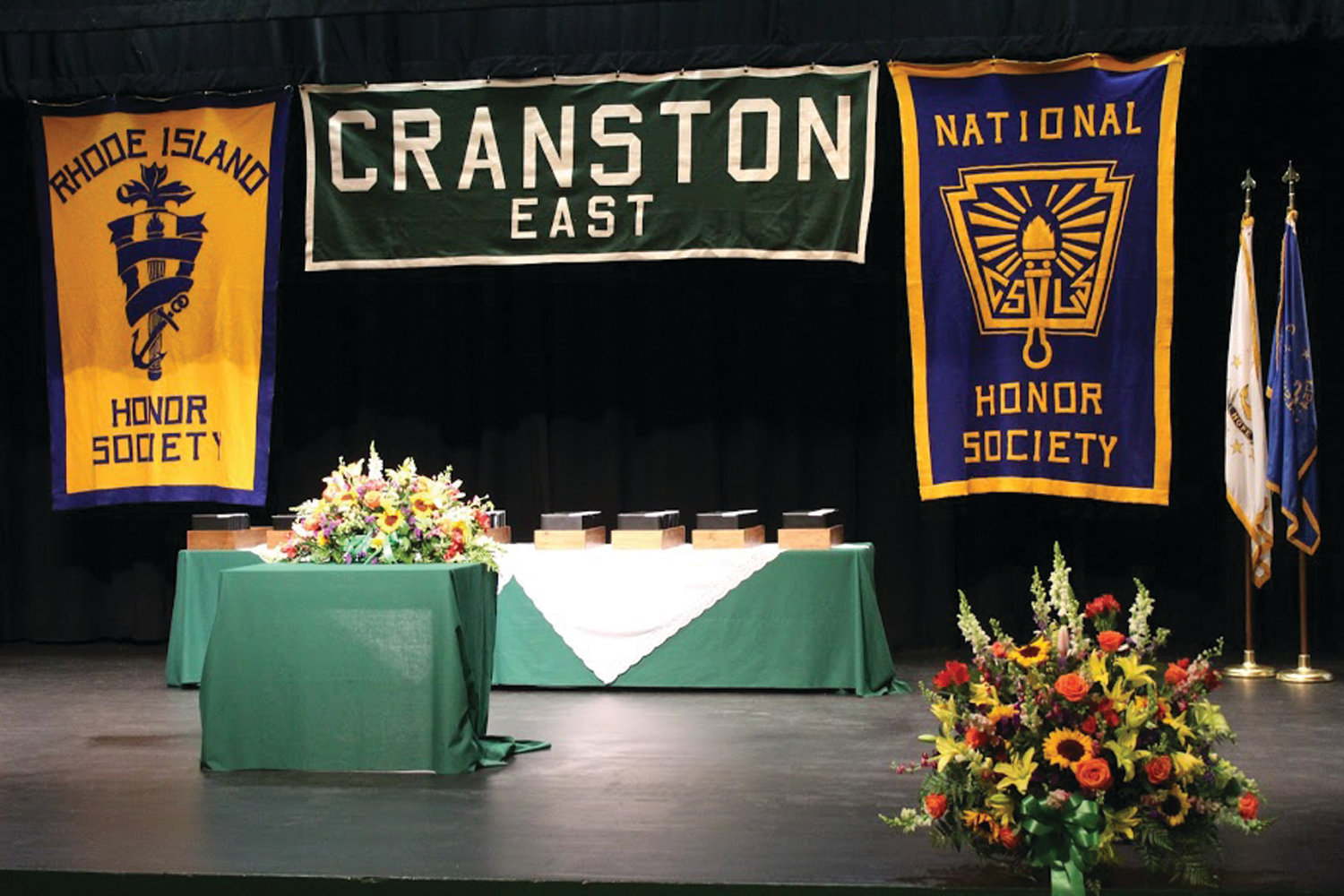 SETTING THE STAGE: Although it may not have been PPAC or the Rhode Island Convention Center, the graduation stage at Cranston High School East was beautifully set with care and attention to detail for this milestone event in the graduates' lives: Graduation 2020.