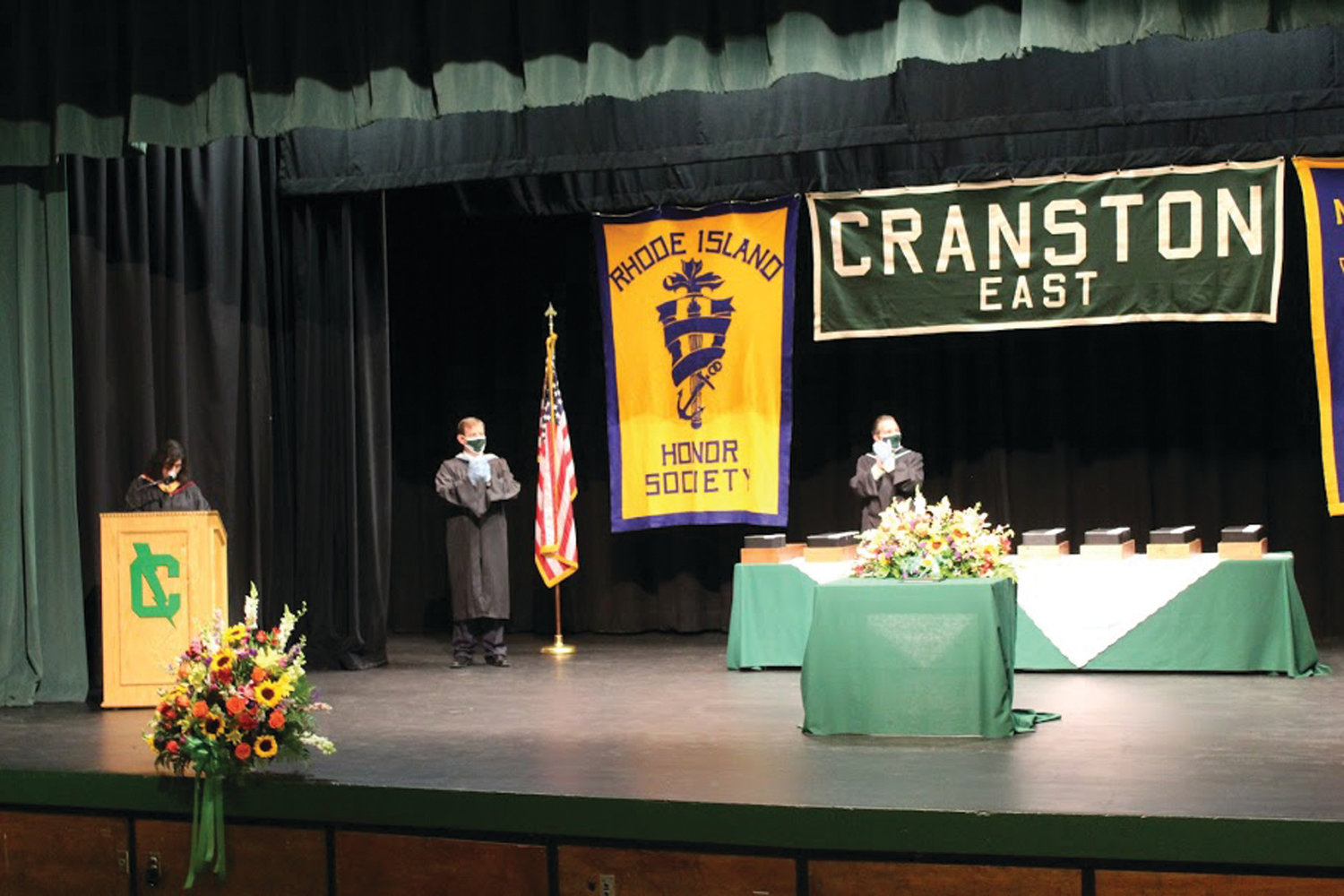 WE'RE SO PROUD OF YOU: Applause and celebratory cheers came for each and every graduate from the members of school administration at Cranston East as names were read aloud and families watched their students cross the stage to receive their diplomas