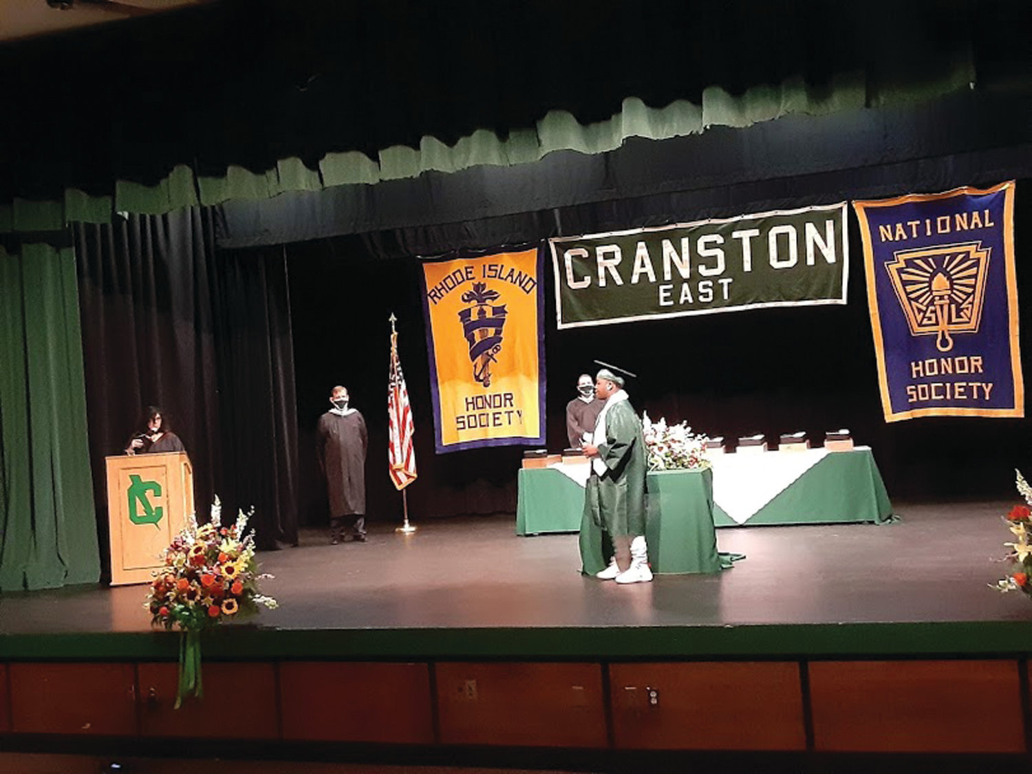 THAT VERY MOMENT: CHSE graduate Amani D. Bell-Ivery accepts his high school diploma and crosses the stage.