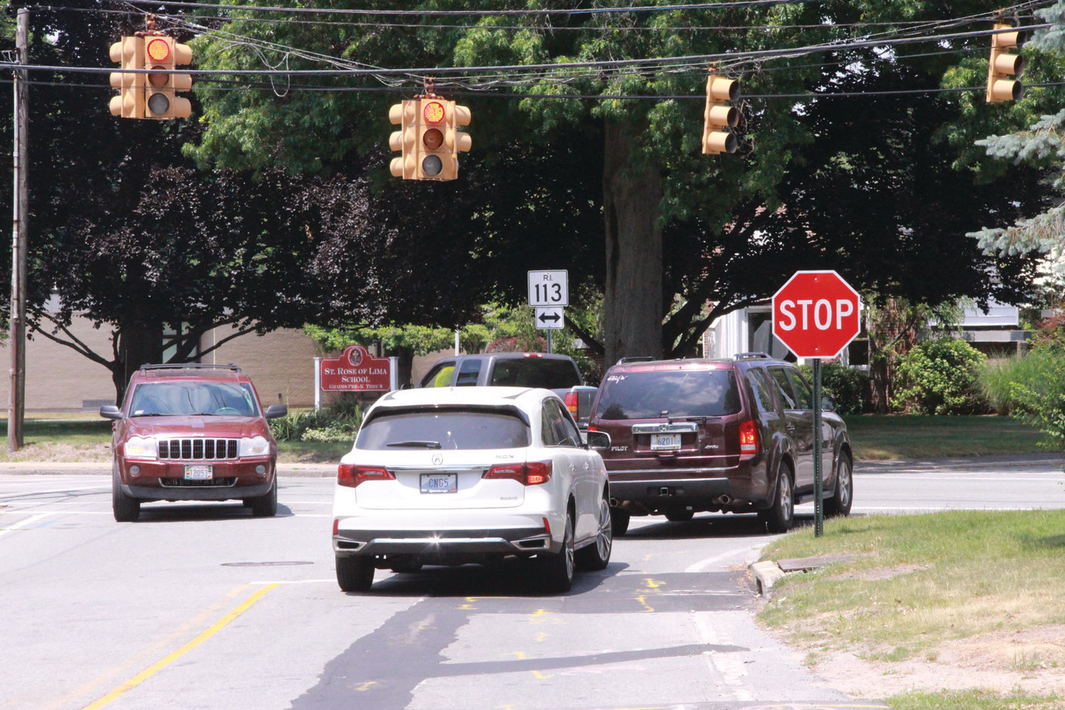 LINING UP:  Vehicles on Buttonwoods Avenue wait for a break in traffic on Main Avenue now that the traffic light is not functioning and been placed on the flashing mode. The intersection has been the site of two accidents since the light was deactivated five weeks ago.