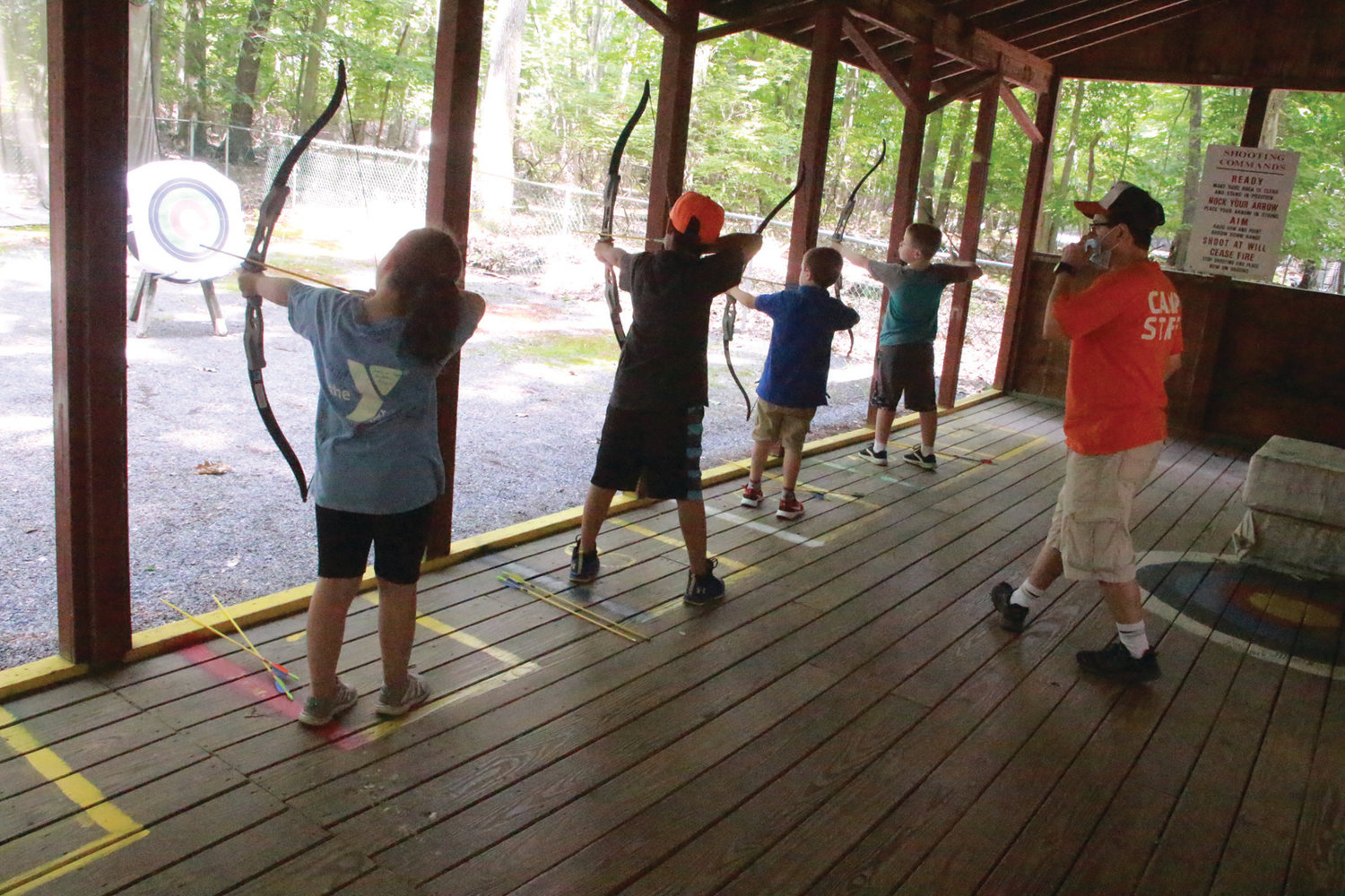 STRAIGHT SHOOTERS: YMCA summer campers take aim at the targets on the first day of camp held Monday.