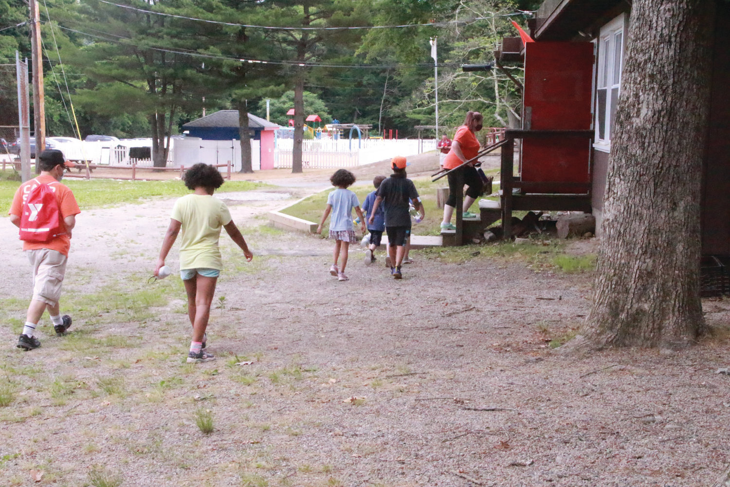 ON TO THE NEXT ACTIVITY: Campers follow their counselor to the next event of the day, which happened to be lunch.