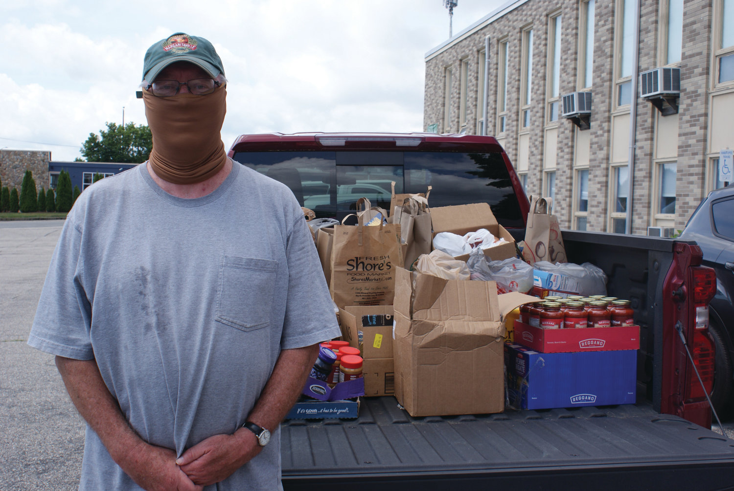 VOLUNTEER EFFORT: Bob Cole is just about ready to make his first trip to bring the collected food donations to the food pantry during Woodridge's Church drop-off food collection.