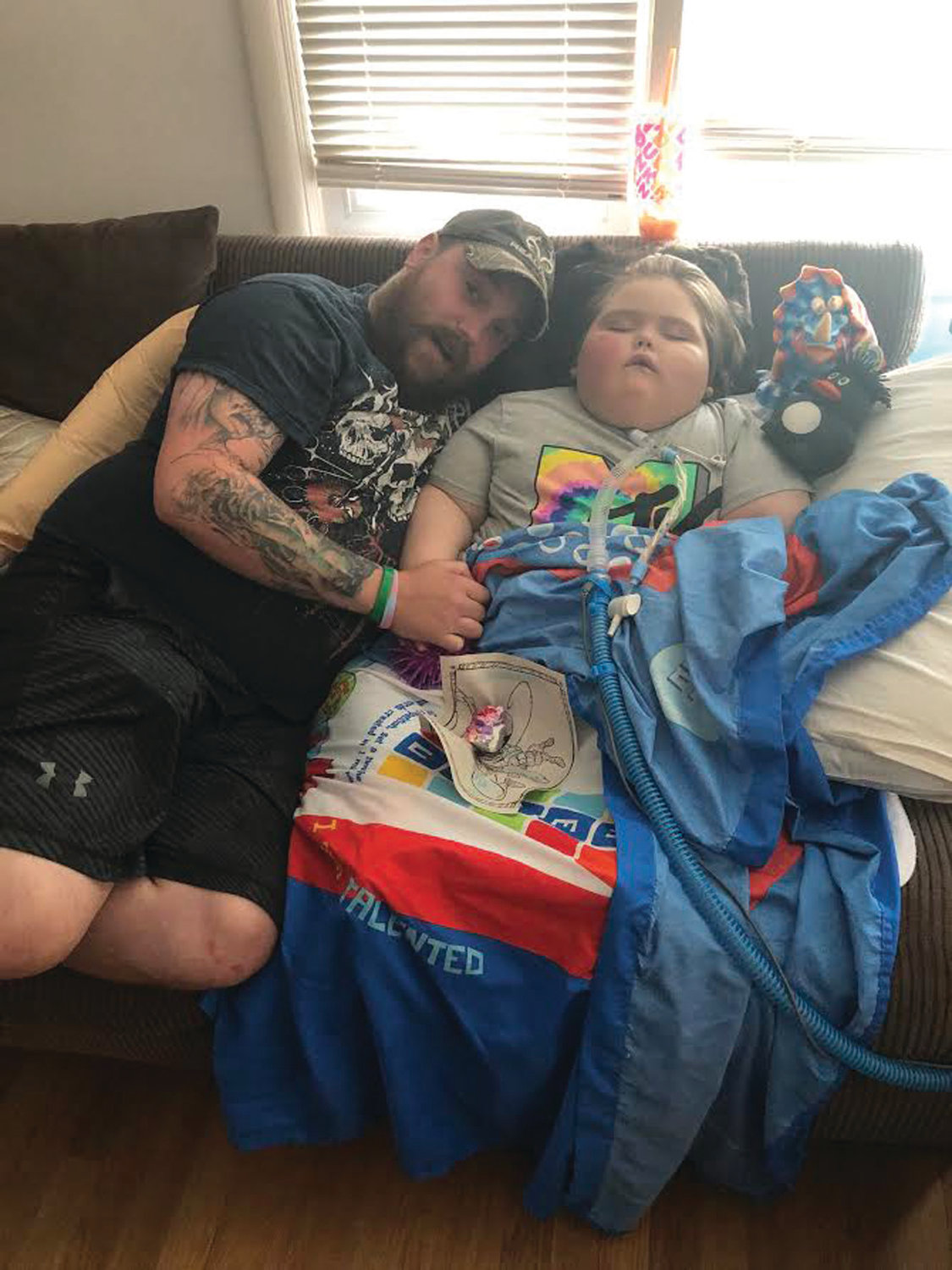 BANNER'S BUDDY: Corey Topp offers his love to his son Banner Topp, 5, who has been battling the rare and incurable disease ROHHAD (Rapid-Onset Obesity with Hypothalamic Hypoventilation and Autonomic Dysregulation) since he was 3.