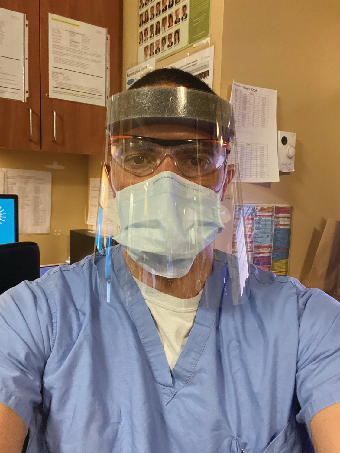 TAKING WORDS TO HEART:  Dr. Luke Messac, seen here geared up for work at Rhode Island Hospital, recently shared a 13-year-old email response from NIH Director Dr. Anthony Fauci. Fauci praised Messac's thesis and said he was confident he would go on to have a successful career.