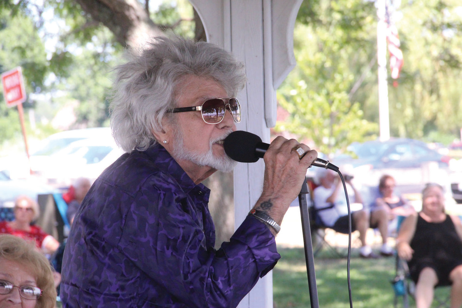 TUNES TO KEEP COOL: Frank Azevedo, known to his fans as Vedo, is a Sunday regular at the Oakland Beach gazebo. He has a loyal following that hum or even dance as he signs popular songs from the 60s and 70s.