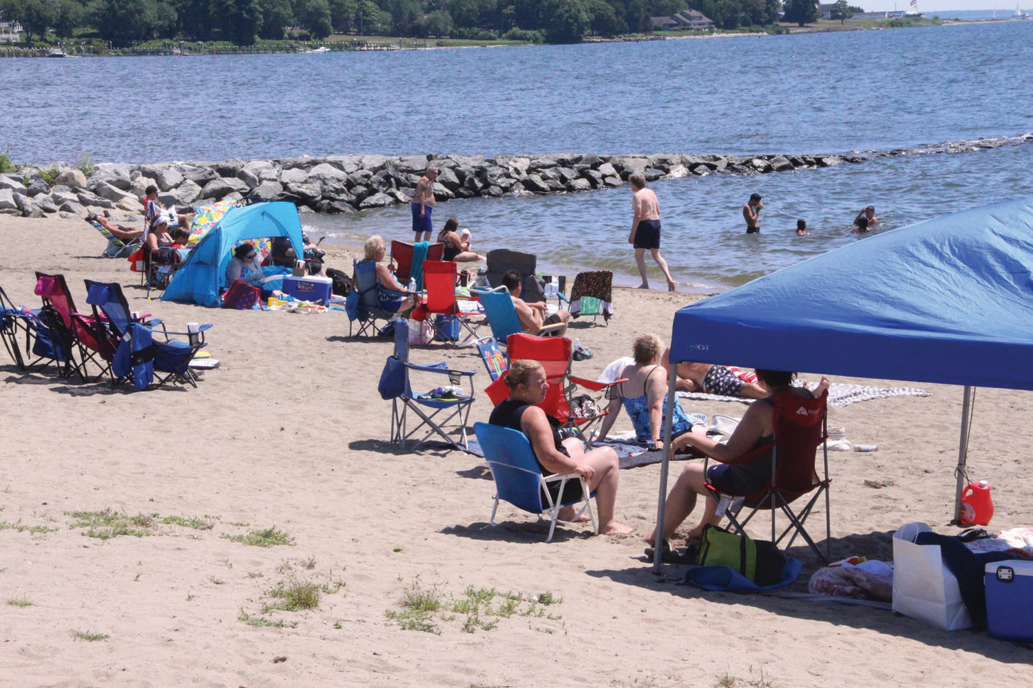 COOLING OFF AT THEIR OWN RISK: Greenwich Bay waters were too inviting during the recent heat wave for people to pay much attention to no lifeguard on duty signs at Oakland Beach.