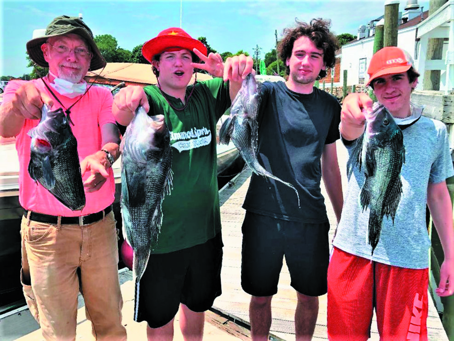 FAMILY FISHING: Duane Clicker and grandsons Owen Jones, John & Julian Gross fished for black sea bass with success this week.