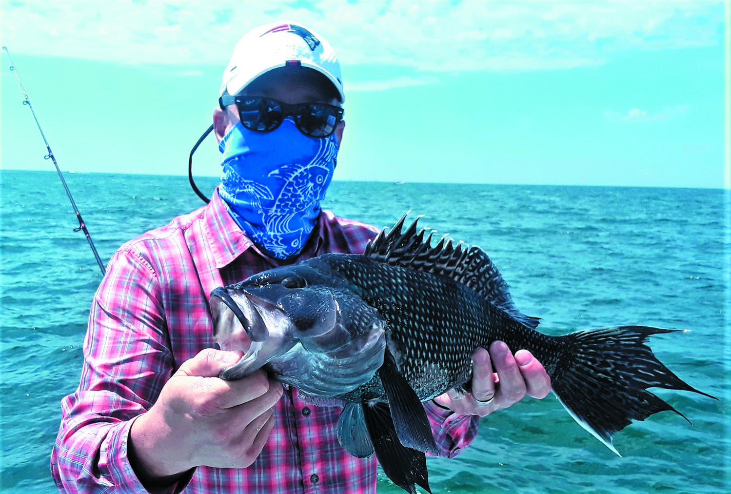 SEA BASS BITE STRONG: Chris Jones of North Kingstown with a 22-inch black sea bass he caught at Elbow Ledge Sunday.