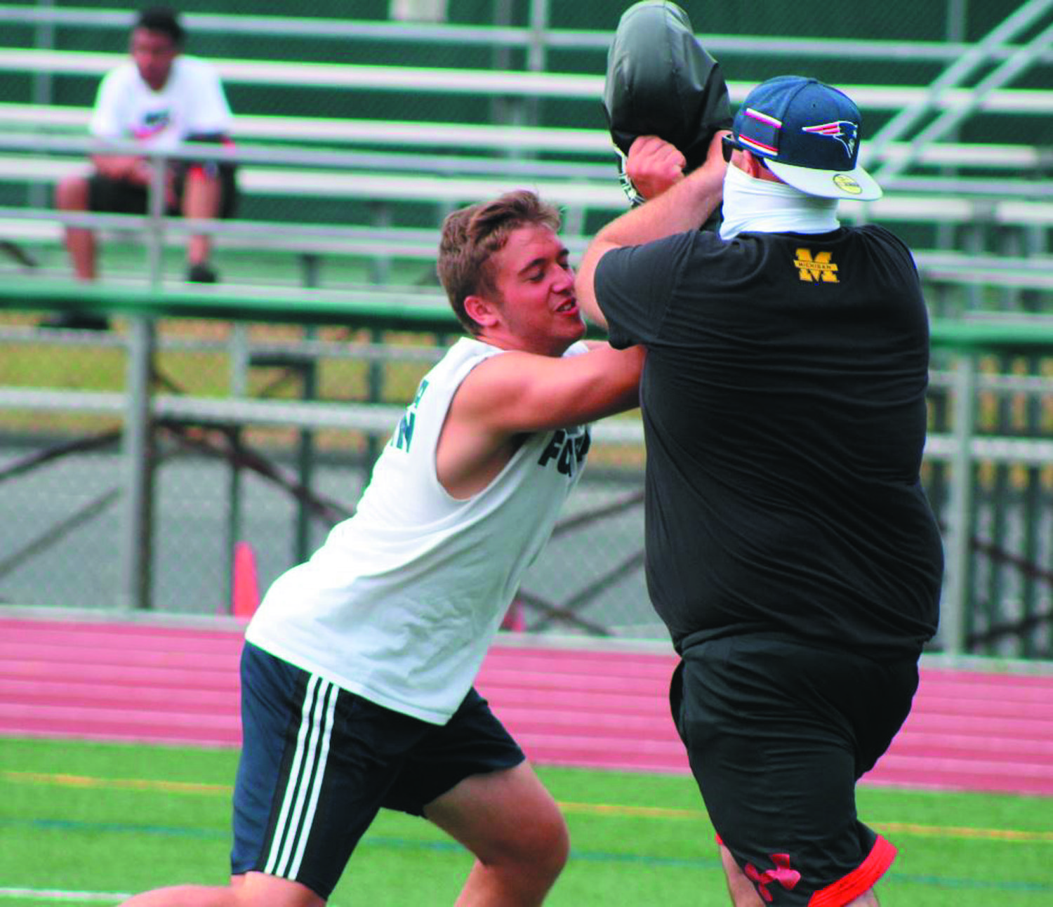 UP FRONT: A lineman works on a blocking drill.