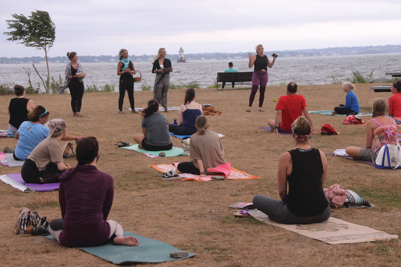 A UNIFYING FORCE: While the moon was obscured and there was a lot of wind and a few rain drops, conditions didn't deter participation at Sunday's Yoga at the Point full moon event. Conimicut resident and board member of the Conimicut Village Association, Lisa Markovich has brought local yoga groups together to promote yoga and the village.