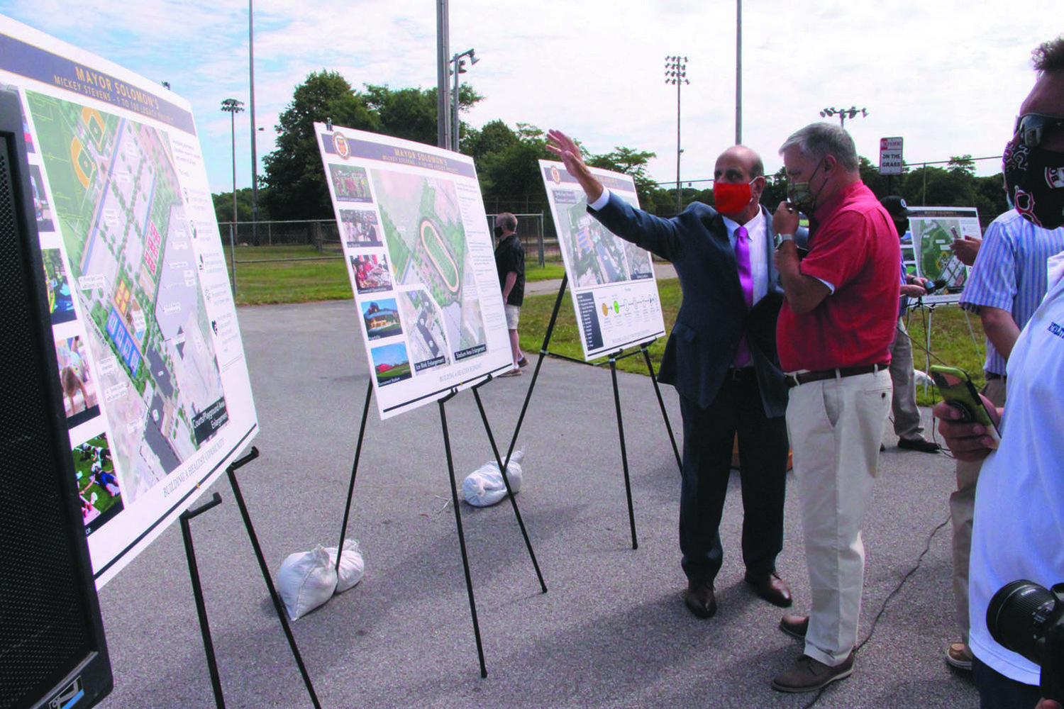 NEW FIELDS: Mayor Joseph Solomon at Mickey Stevens after unveiling the plans.