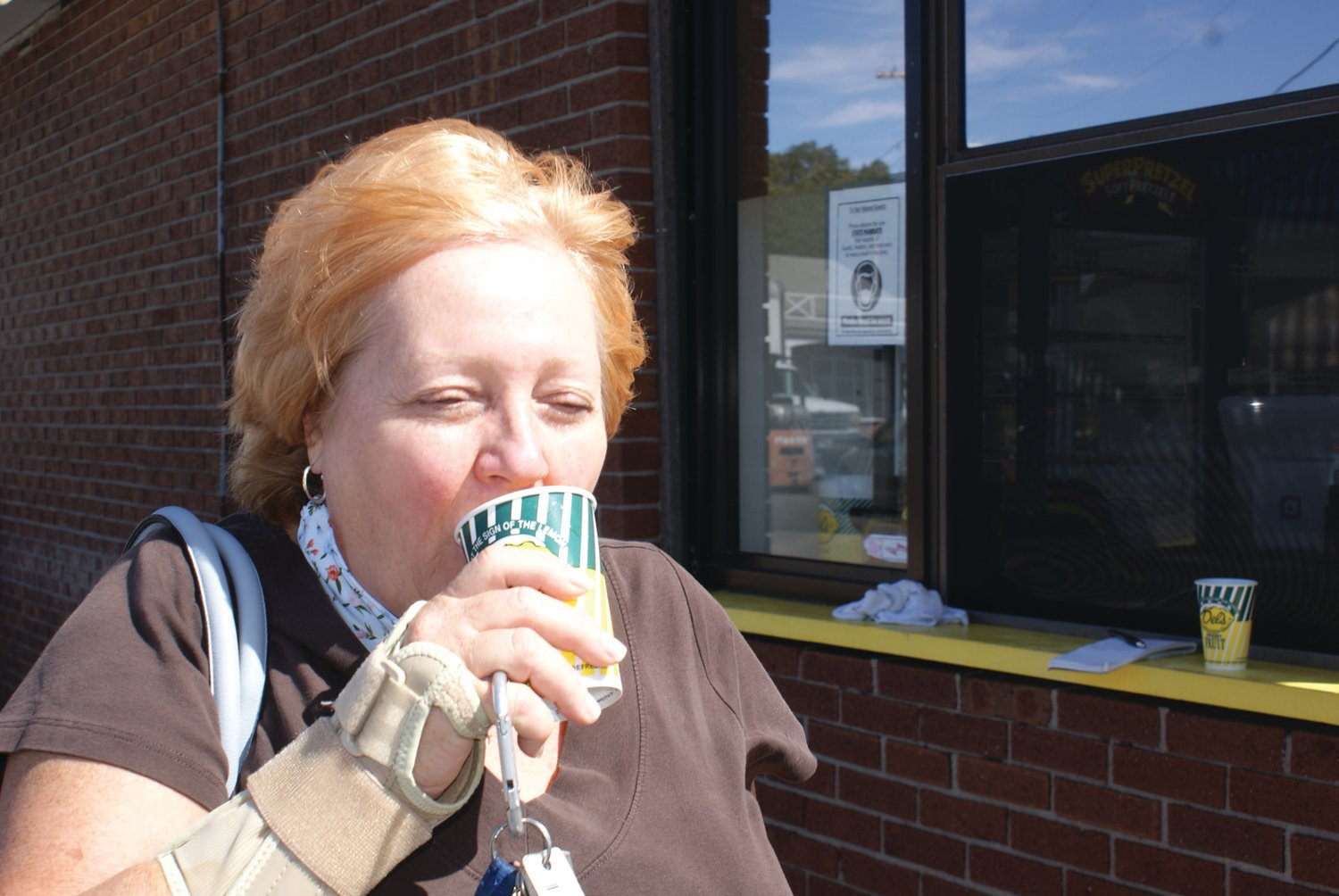 "THE FIRST SIP: Mary Lou Petrarca took her first sips and said, ""I like the taste of pumpkin and I can really taste it."""