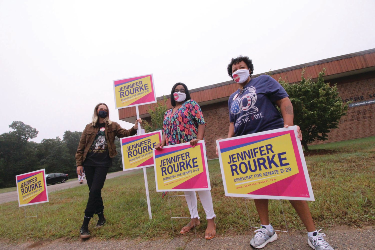 OUT THERE: Senate Dist. 29 candidate Jennifer Rourke, center, is flanked by supporters Madison Esmond and Chris Varon at the Hoxsie School poll.