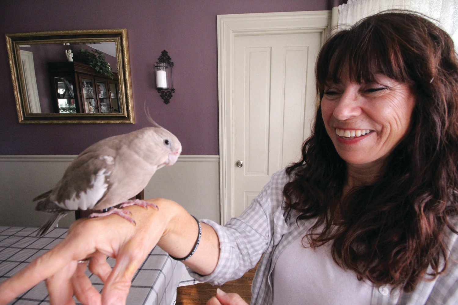 HOME AGAIN: Lidia Goodinson with her pet cockatiel, Joy.