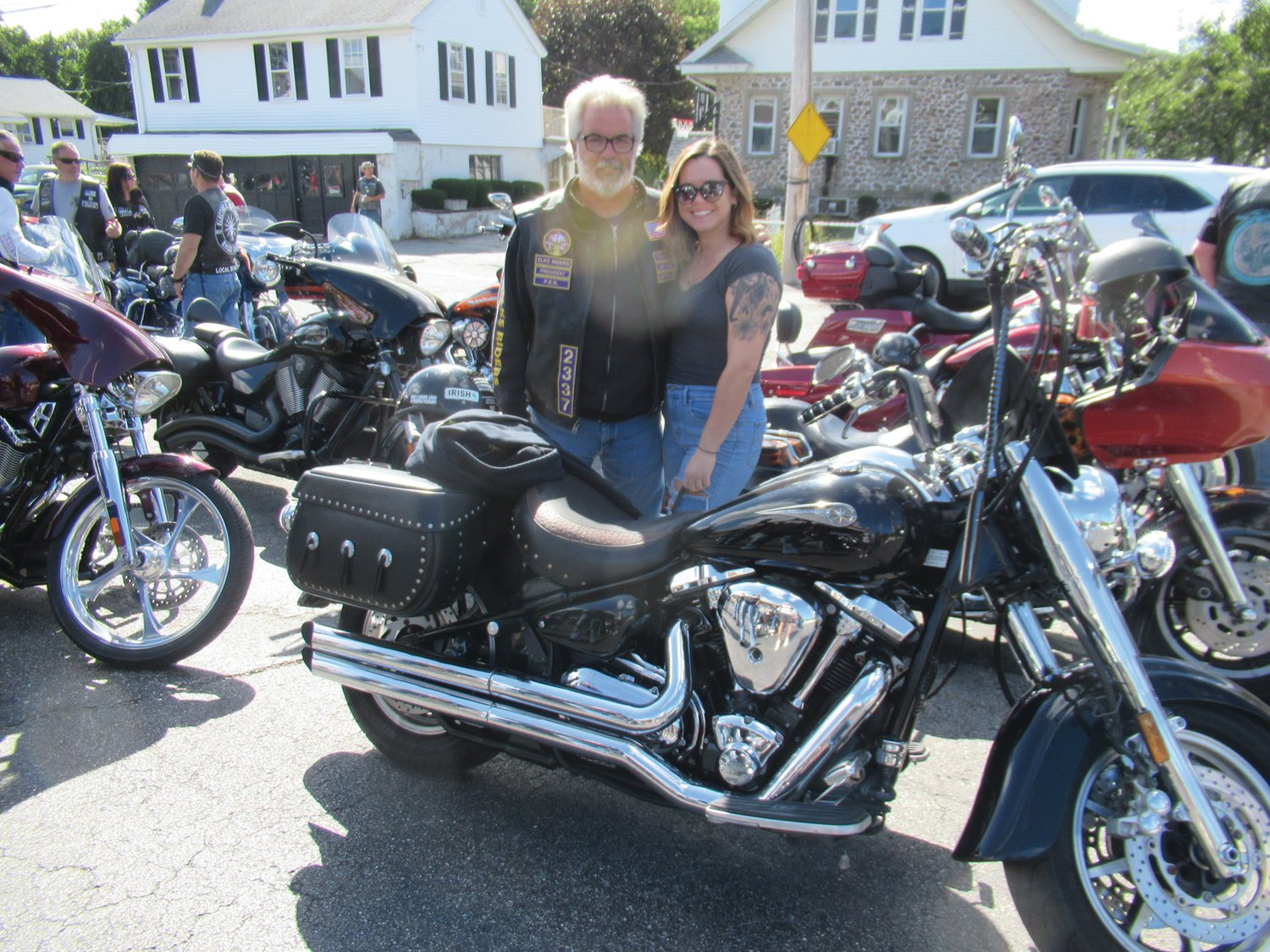 FOUNDING FATHER: Mike Ottone, president of the East Providence Elks Motorcycle Club – which was the first nonprofit of its kind in the country and has since swelled to 165 different clubs – is joined by his daughter Morgan prior to Saturday's Goodfellas Run.