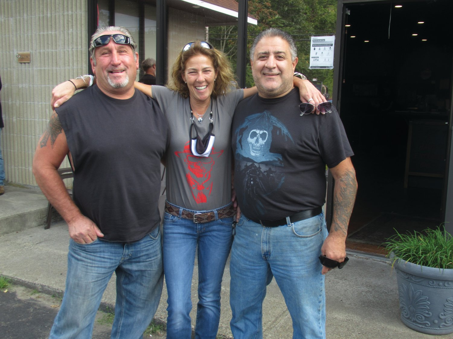 POPULAR PROPRIETOR: Stephanie Harris, who owns and operates Strings Bar & Grille in Johnston, is joined by Joe Pingitore (left) — who she rode with during Saturday's Goodfellas Motorcycle Run – and her chef Al Forte, who helped make the pre-fun festivities a special success.