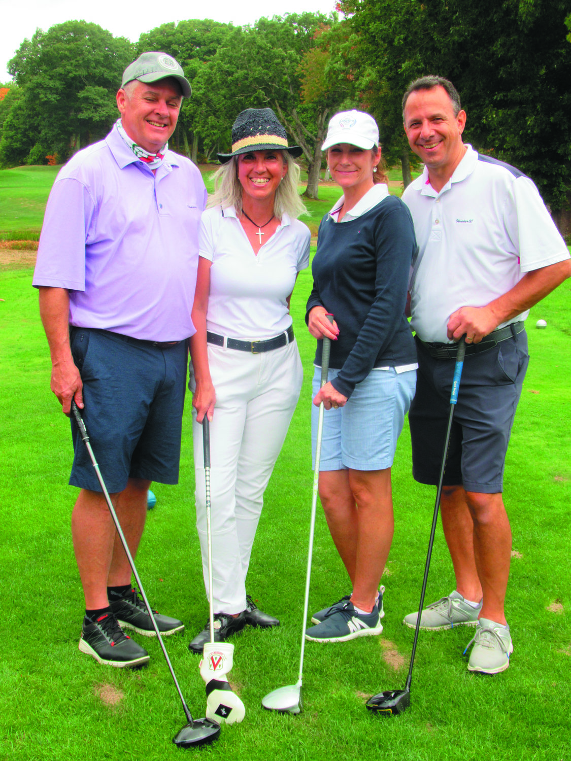 MIGHTY MEMBERS: Among the many GCC members who again turned out to support the JMCE Co-Ed Memorial Golf Tournament are from left: Walter and Michy Geer and Tracy and Dewey Uriati.