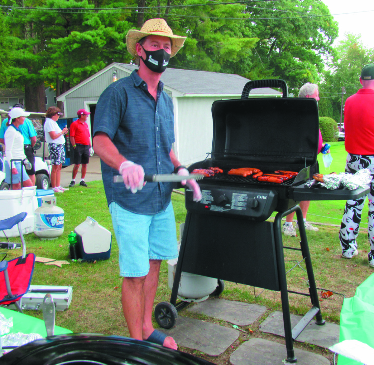 SPECIAL SUPPORTER: Todd Curley, who JMCE Co-Ed Memorial Golf Tournament officials praised for always supporting the event, did everything form cook char-broiled hot dogs and prepare homemade meatball and sausage and pepper sandwiches Sunday's record-setting golf tourney.