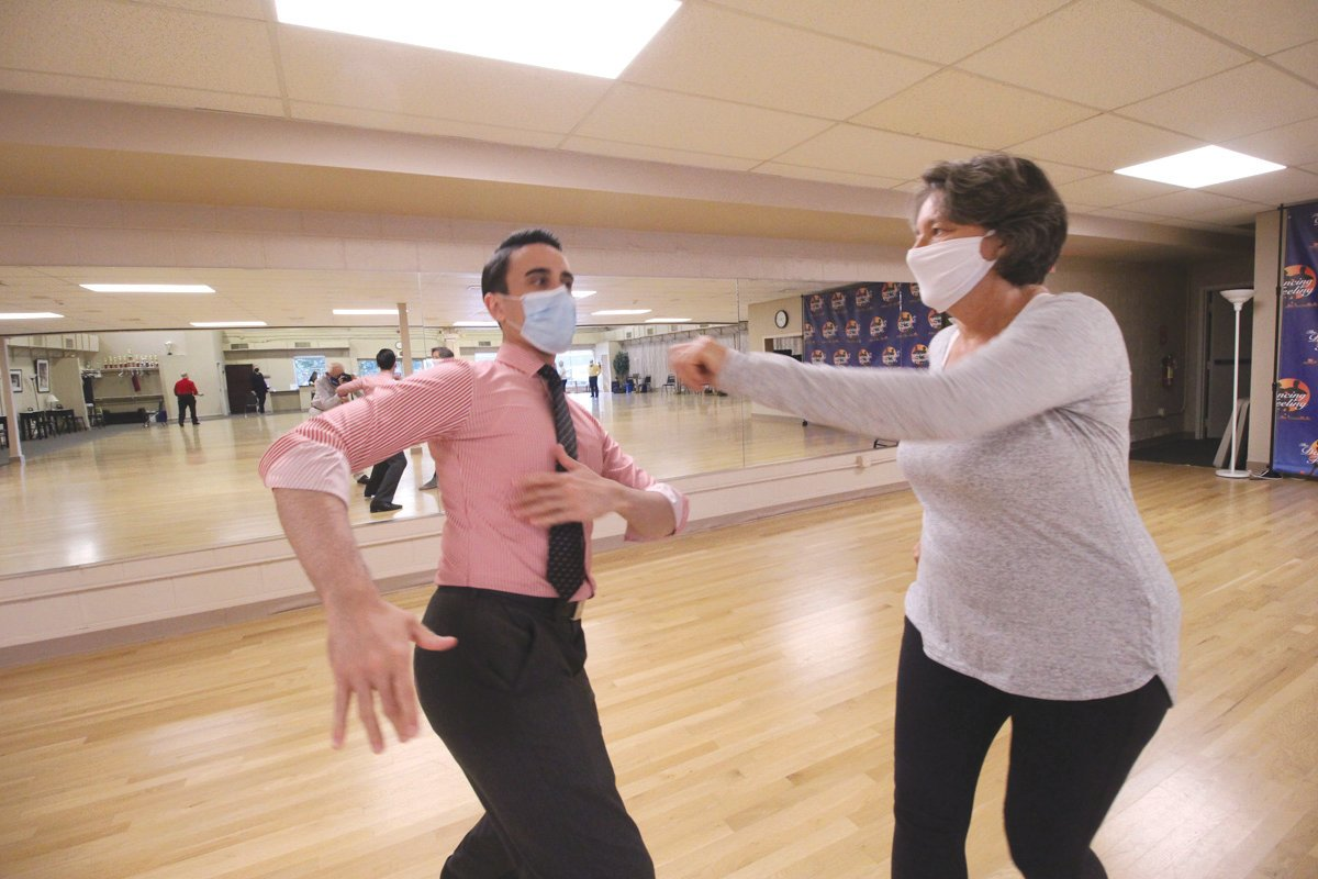 IN THE SWING: Jo-Ann Schofield and Anthony Scalzi practice their routine.