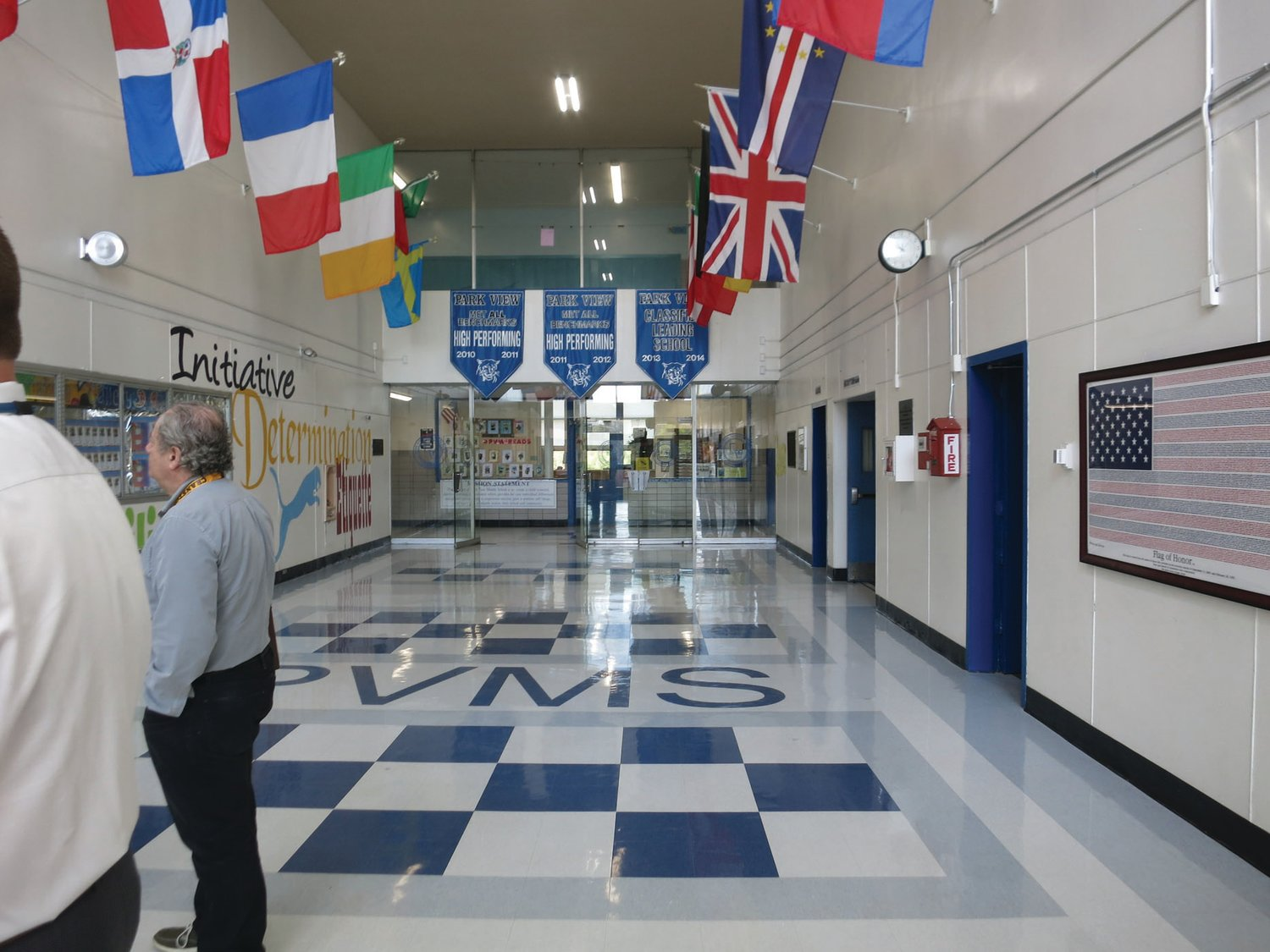 WHAT WE HAVE NOW: Currently, the entryway and lobby at Park View provide access to both the gymnasium and the auditorium, while the main office check-in and waiting area for visitors to the school and students awaiting pickup is through the glass doors and hallway ahead.