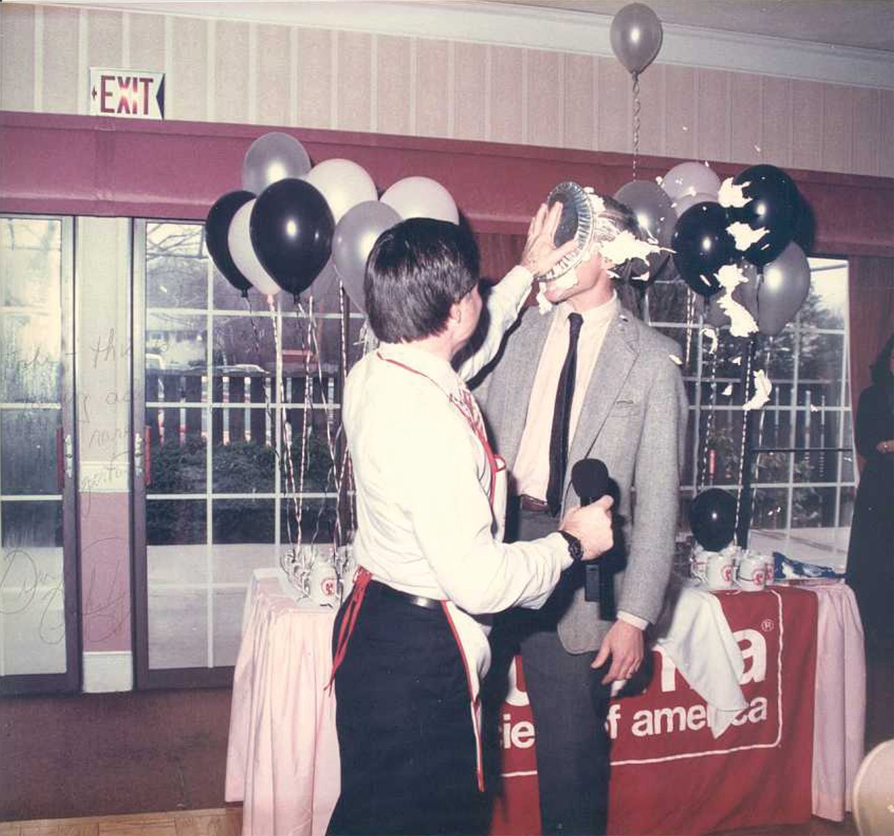 ALL FOR A GOOD CAUSE:  As mayor of Warwick, Francis X. Flaherty often assumed the role of master of ceremonies at nonprofit fundraising events – and as seen here, even threw a pie or two. The recipient is John Howell, who was covering (or, should we say got covered) for the event.