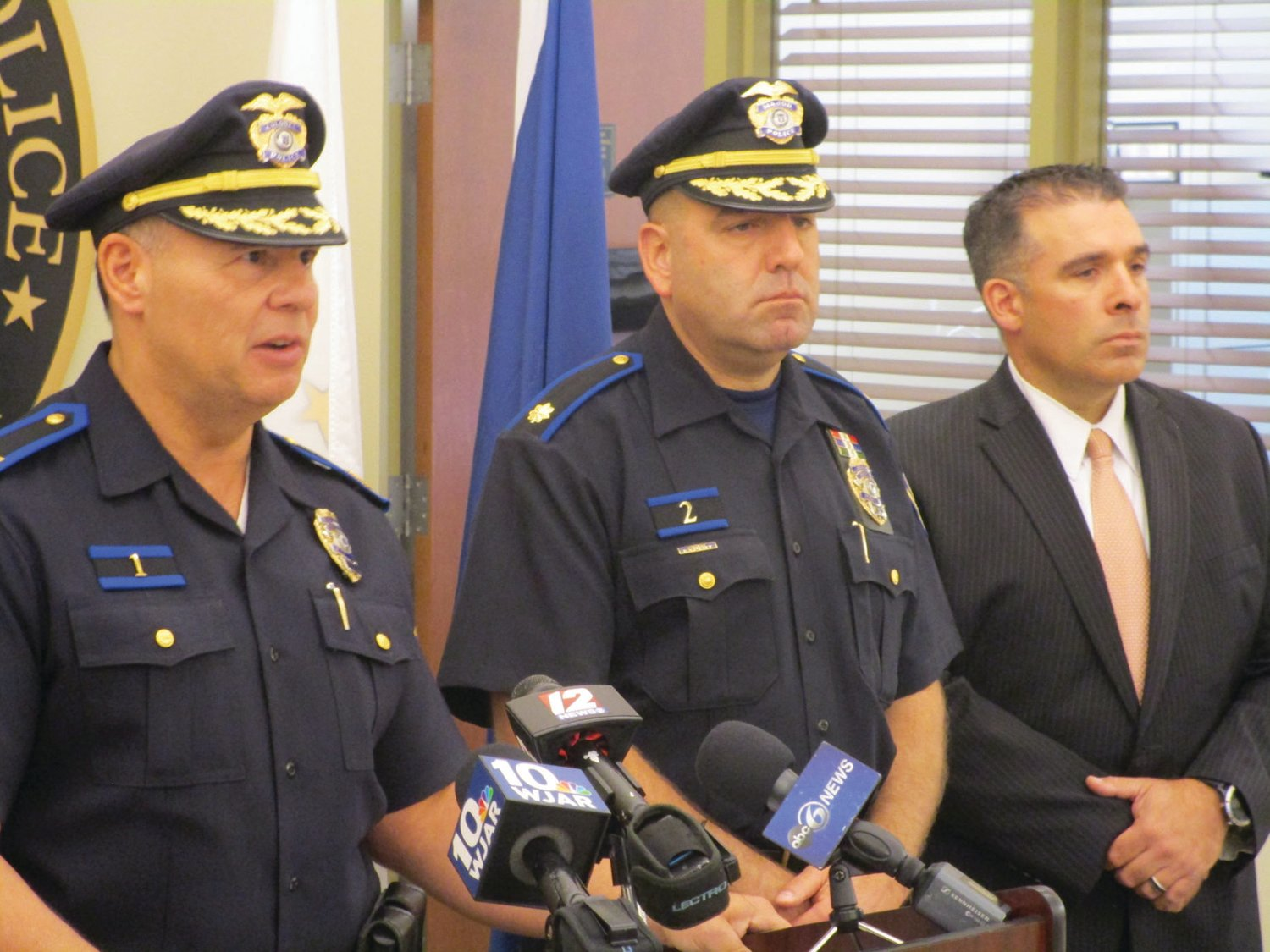 ARREST ANNOUNCED: Chief of Police Michael Winquist addresses members of the media during a press conference announcing the arrest of a murder suspect. Also pictured, from left, are Mayor Allan Fung, Maj. Todd Patalano and Capt. Vincent McAteer.