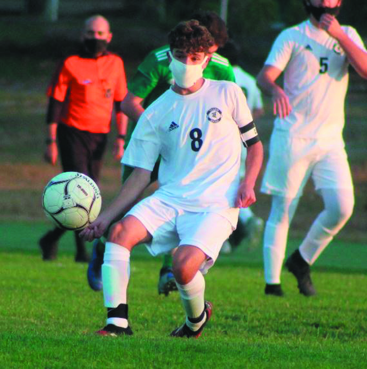 UP THE FIELD: Pilgrim's Matthew Gibeau passes the ball during the team's opener.