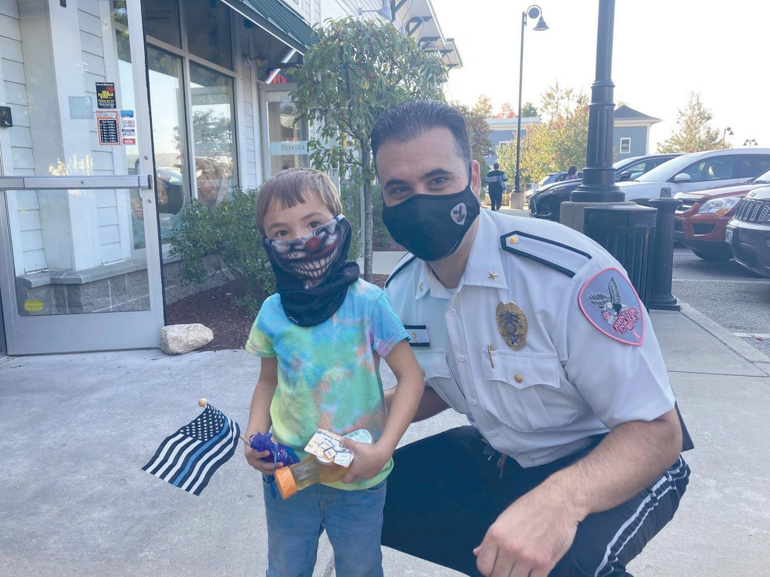 KINDERGARTEN COP: Four-year-old Wyatt Desanto wanted to show Deputy Chief Mark Vieira his scary clown mask.