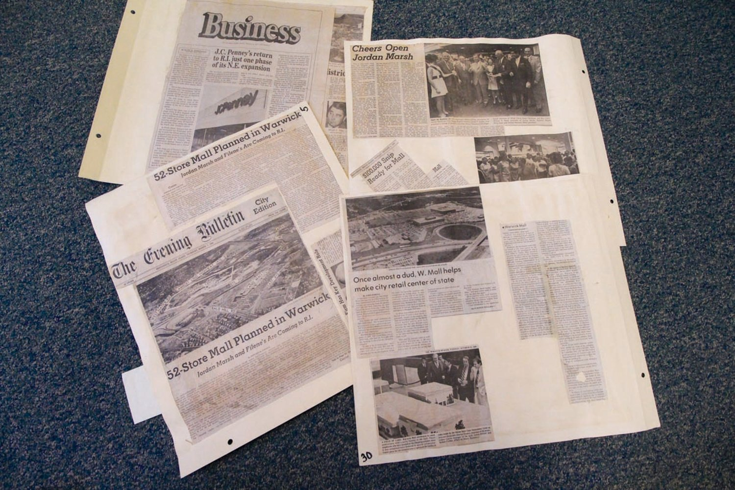MAKING HEADLINES: Developments at the mall carried the headlines in local and state papers. These are some of the many clippings Lloyd Bliss saved in one of several albums.