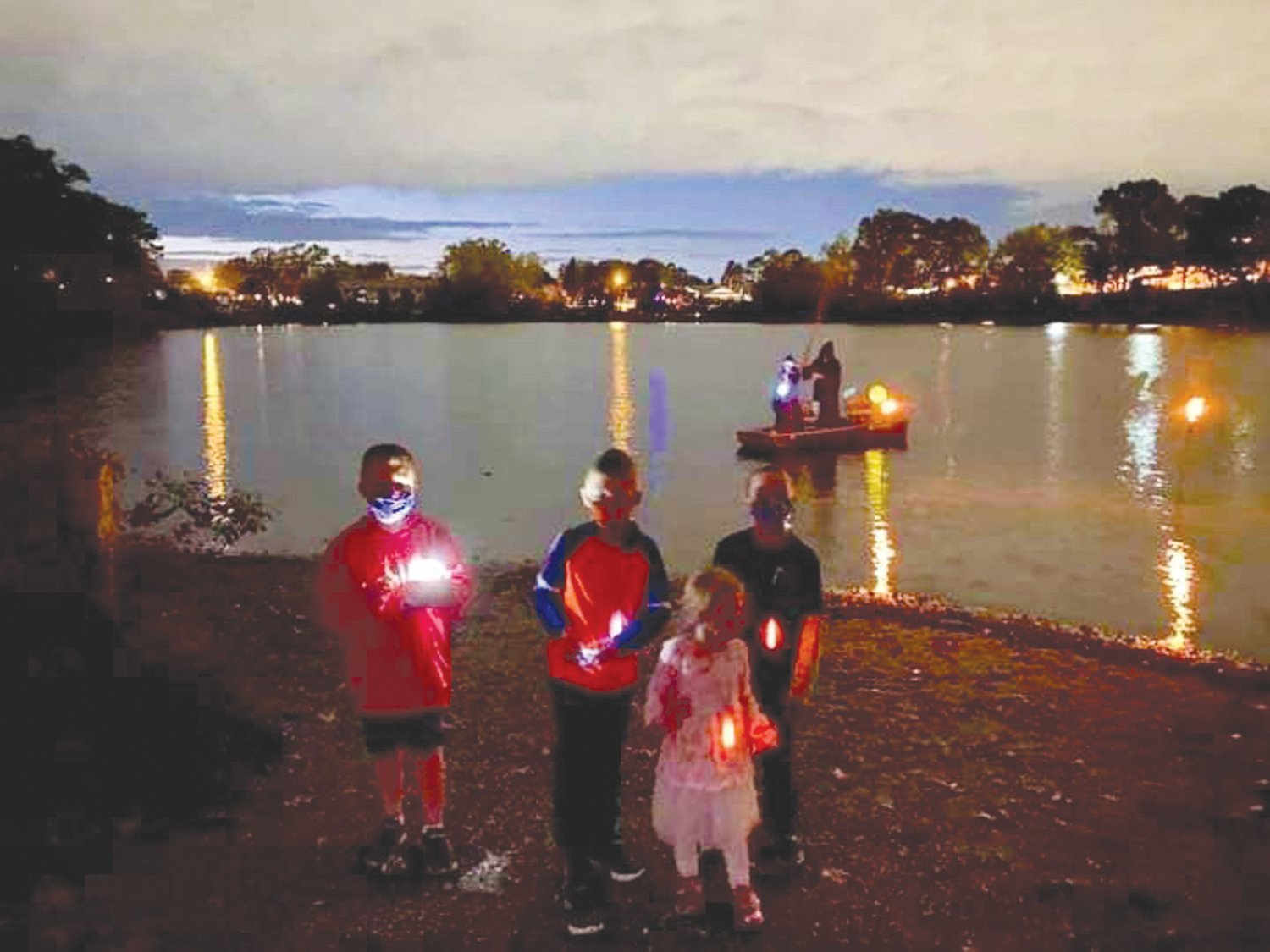 BY LAND AND POND: Dressed for the occasion Sand Pond neighbors celebrated Halloween Oct. 24.